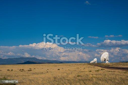 Satellite antennas on grass field