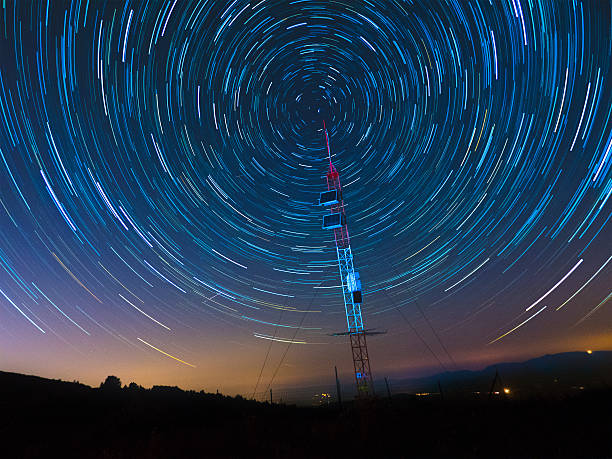 Satellite Communications Under A Starry Sky Satellite Communications Under A Starry Sky telecommunications equipment stock pictures, royalty-free photos & images