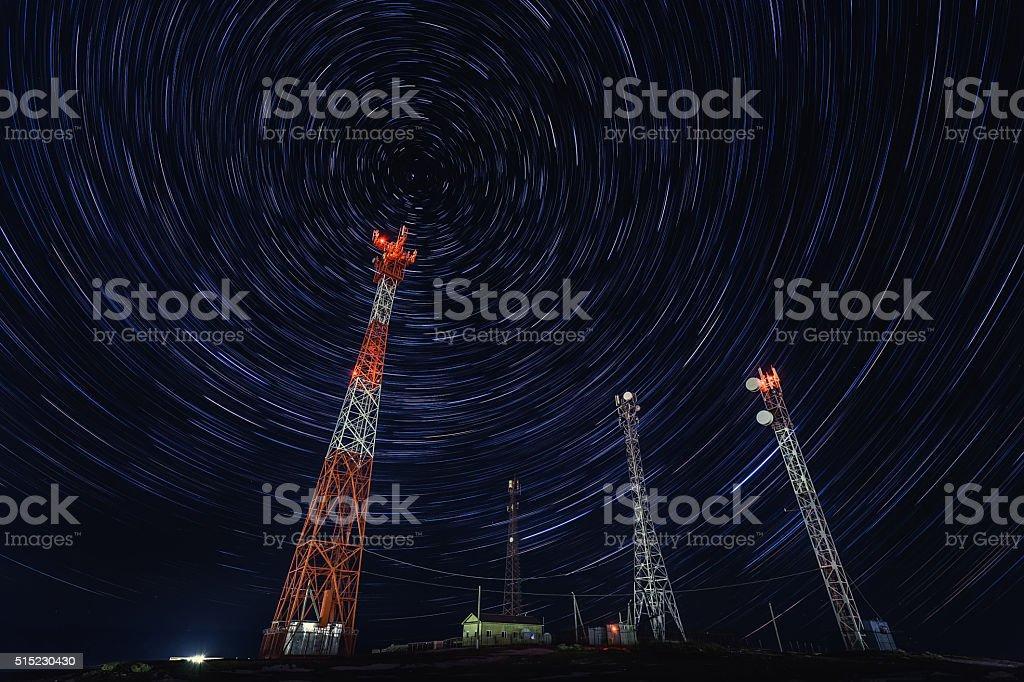 Satellite Communications Under A Starry Sky stock photo