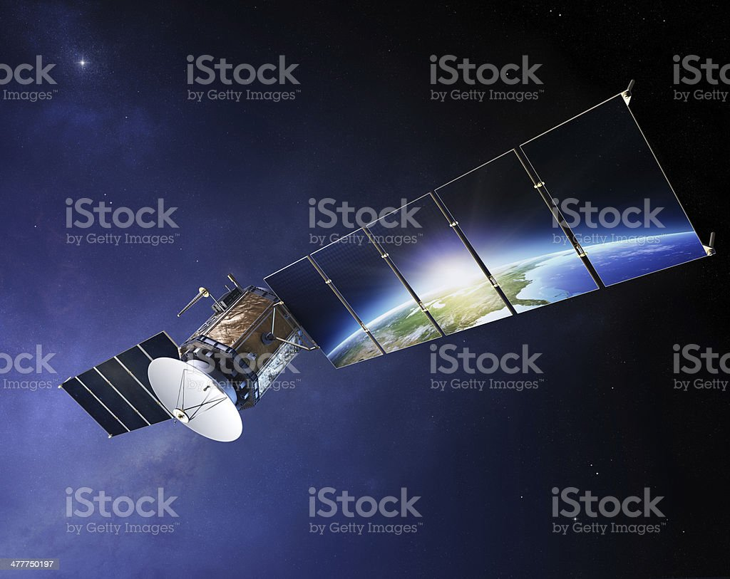 Satellite communications with earth reflecting in solar panels stock photo