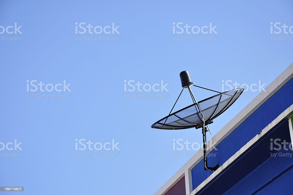 Satellite dish antenna for television on house roof, Thailand. royalty-free stock photo