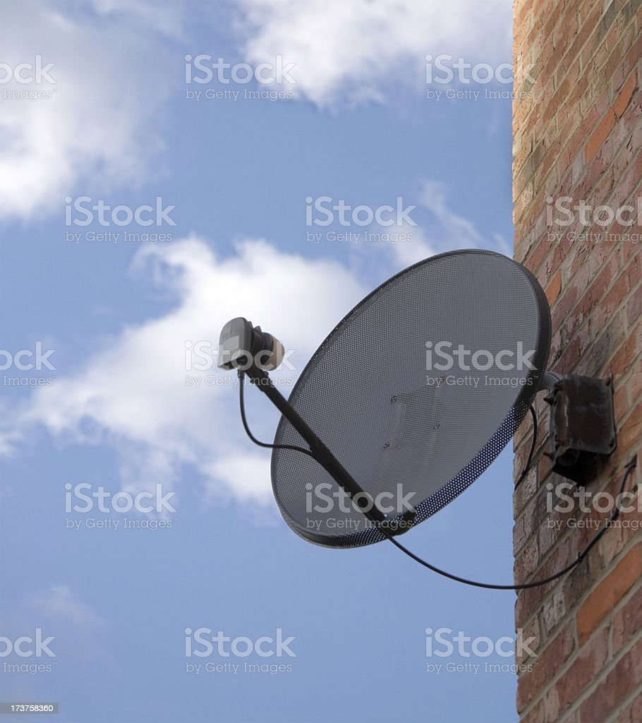 Satellite Dish Attached to Brick Wall-See below for more royalty-free stock photo