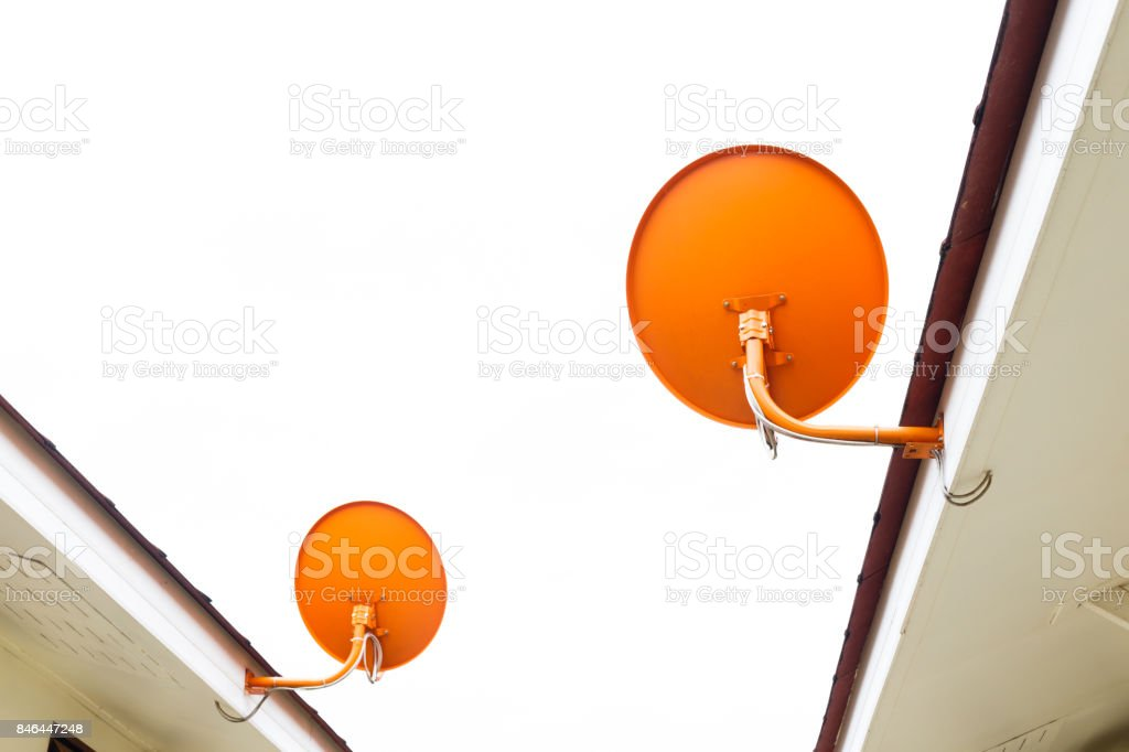 Satellite dish attached to the roof of the houseSatellite dish attached to the roof of the house isolated on white background. stock photo