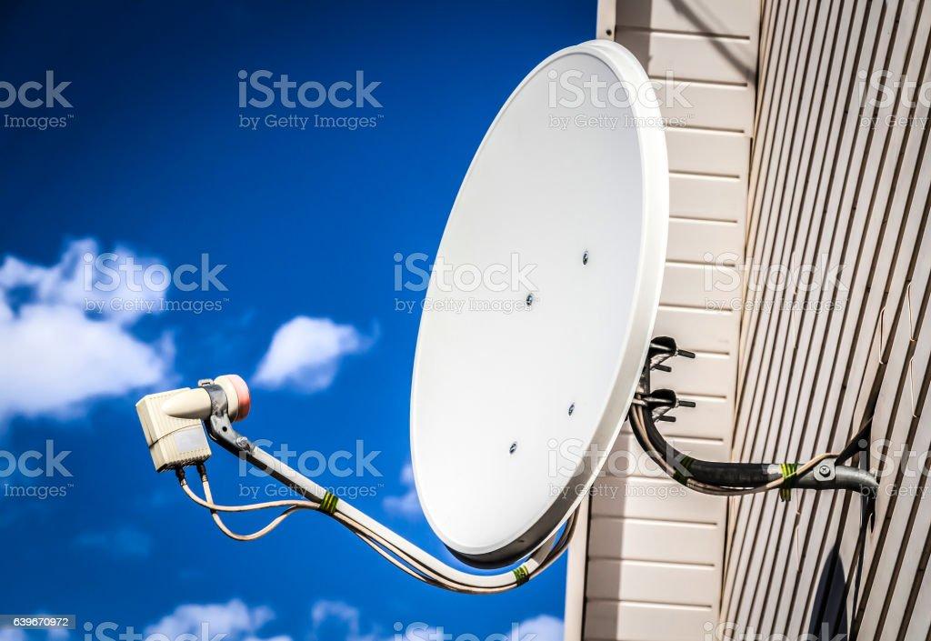 Satellite dish on a house stock photo