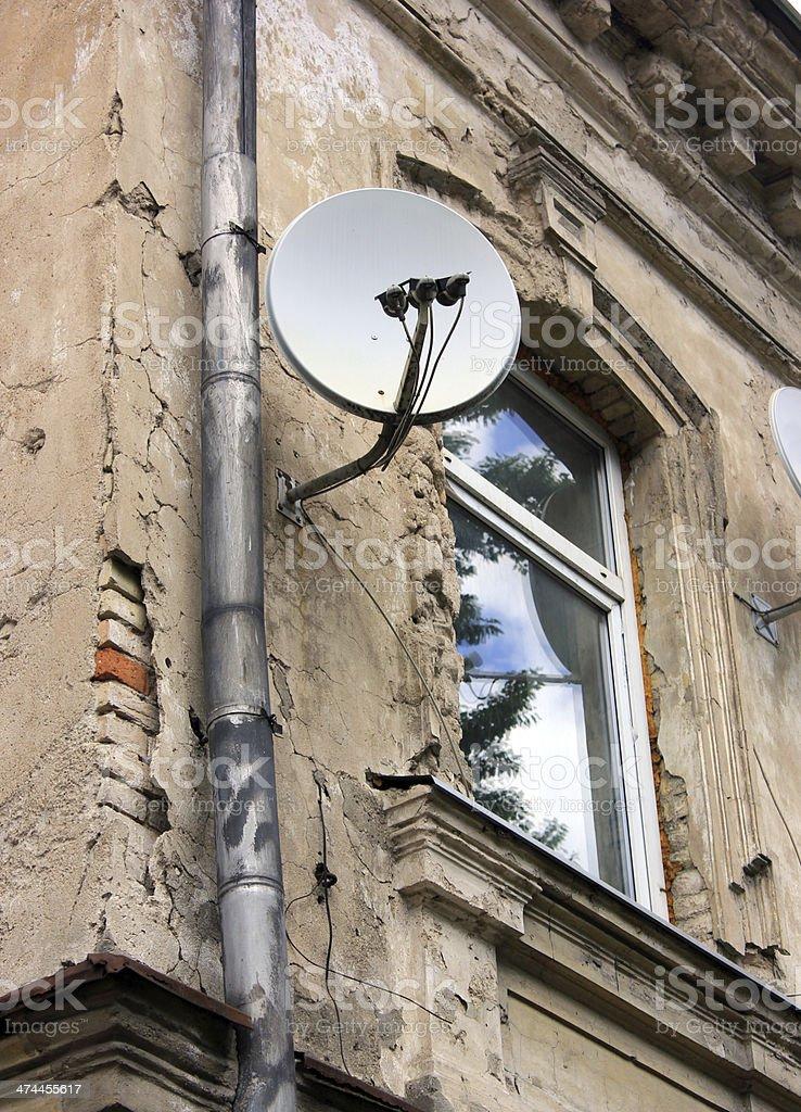 Satellite Dish On Old House stock photo