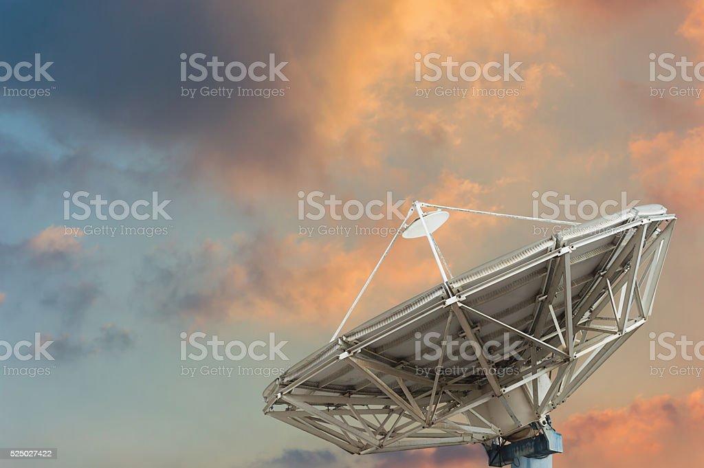 Satellite dish on sun set background stock photo