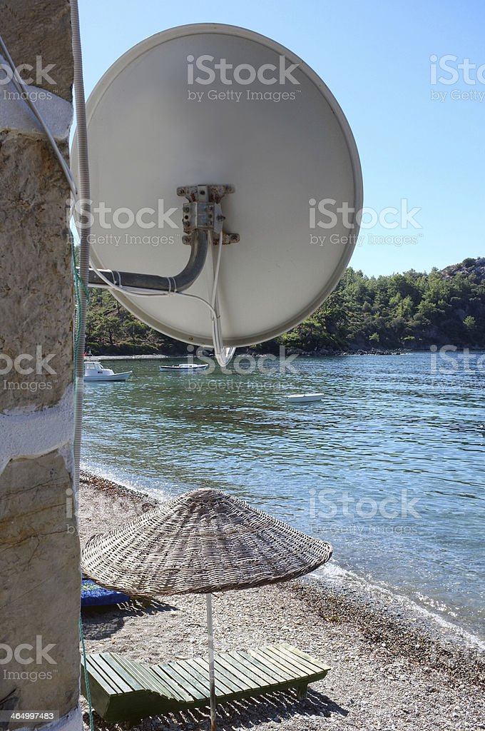 Satellite dish on the beach stock photo