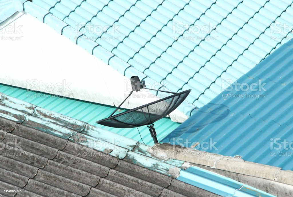 satellite dish on the house roof royalty-free stock photo