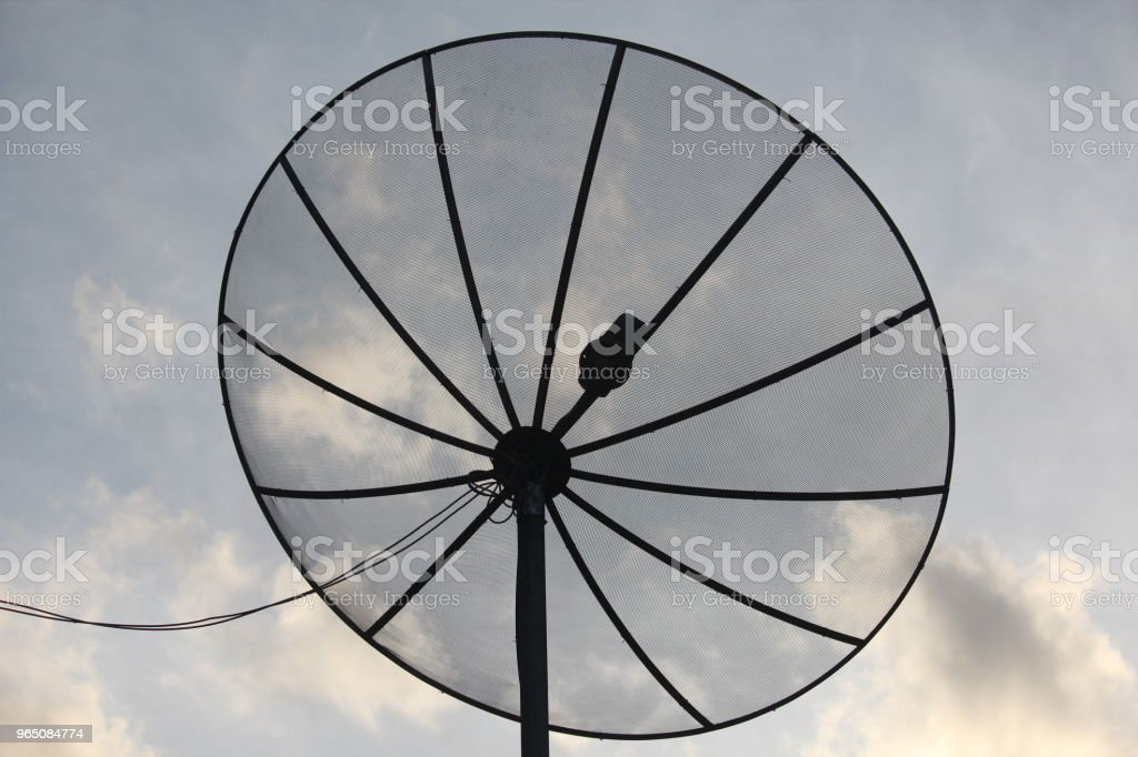 Satellite dish on top of the building royalty-free stock photo
