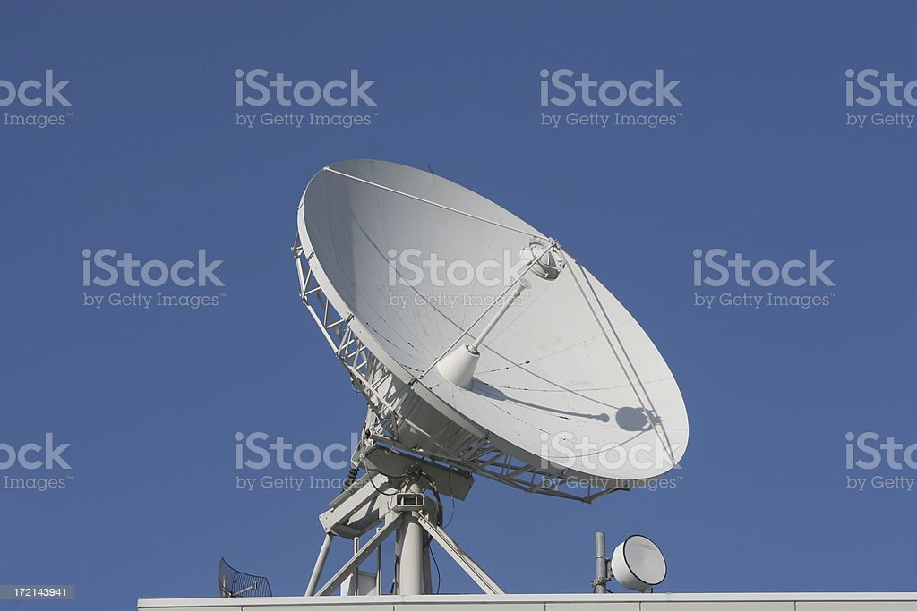 Satellite dish - rooftop mounted royalty-free stock photo