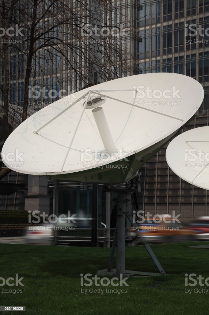 Satellite dish space technology receivers with modern buildings backgrounds royalty-free 스톡 사진