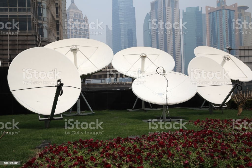Satellite dish space technology receivers with modern buildings foto de stock royalty-free