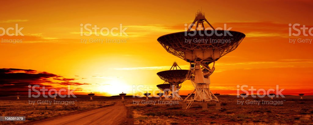 XL satellite dish sunset stock photo