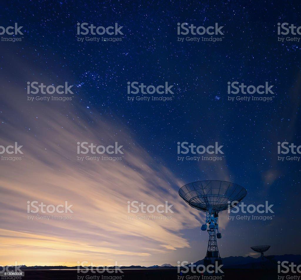 satellite dish under a starry sky stock photo