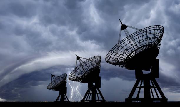 satellite dishes at thundershtorm. - radar foto e immagini stock