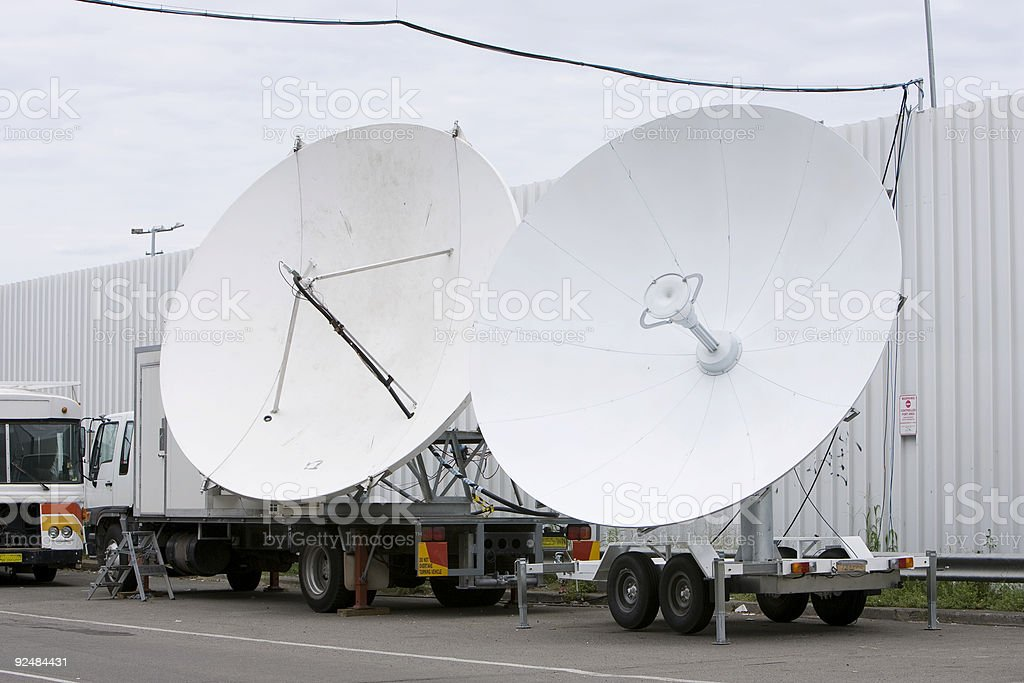 Satellite dishes beaming TV pictures royalty-free stock photo