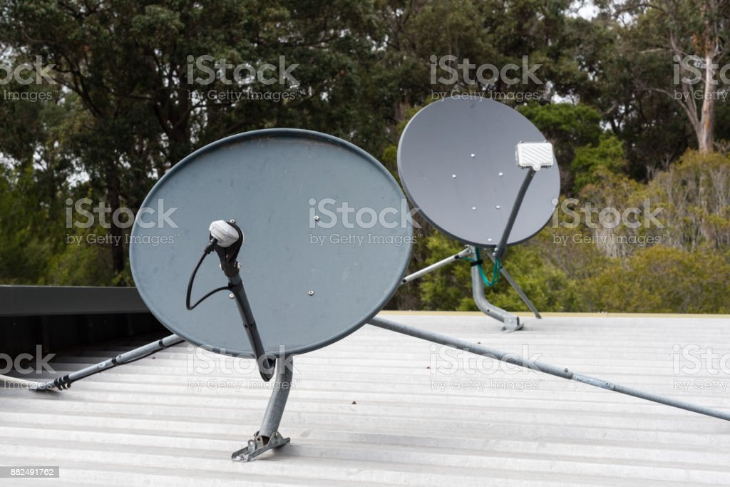 Satellite dishes for internet and digital television on roof stock photo