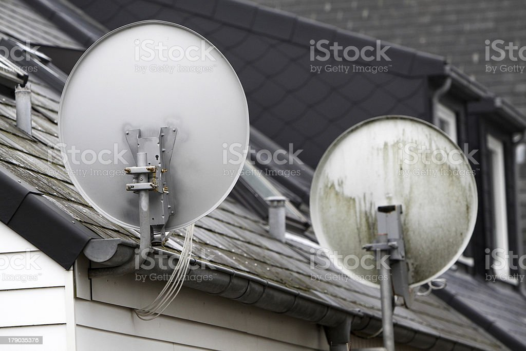 Satellite dishes on a house stock photo
