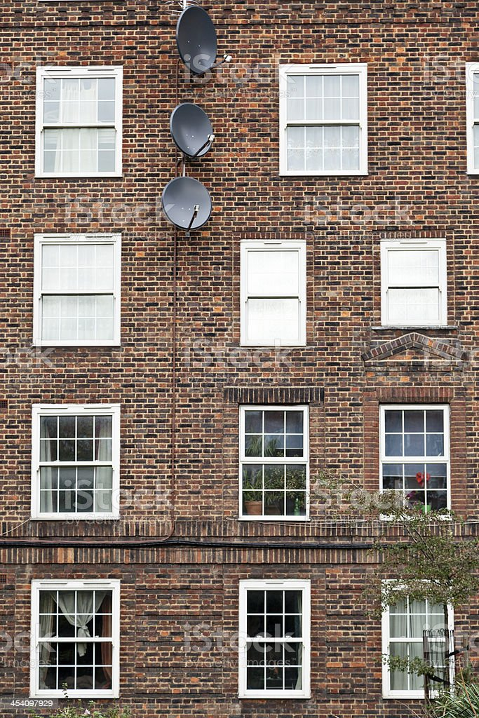 Satellite dishes on appartments royalty-free stock photo