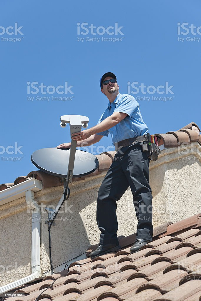 Satellite Installer on Roof royalty-free stock photo