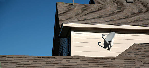 Satellite on back of suburban home  bunnylady stock pictures, royalty-free photos & images