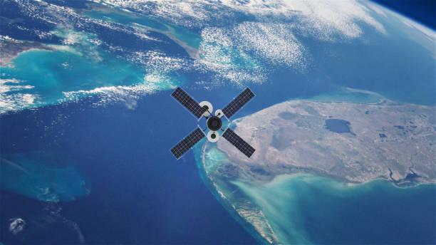 satelliet in een baan om aarde - luchtvaartindustrie stockfoto's en -beelden