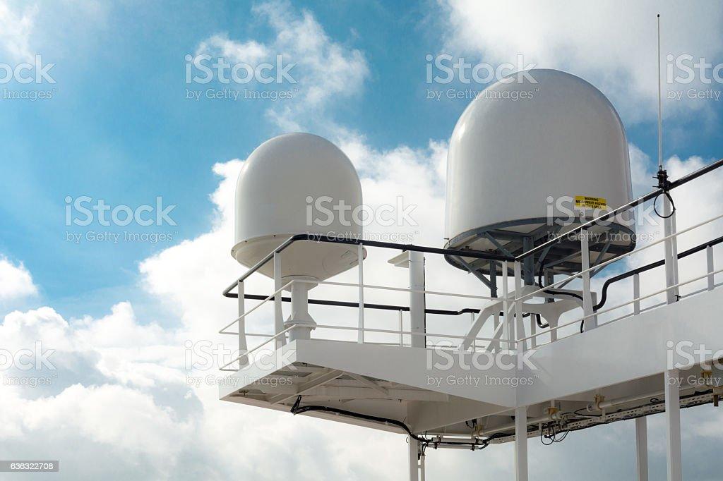 Satellite receiver and radar on bridge of large industrial ship stock photo