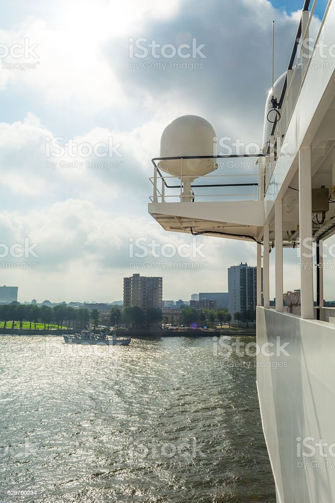 Satellite receiver on bridge of large industrial ship on river stock photo