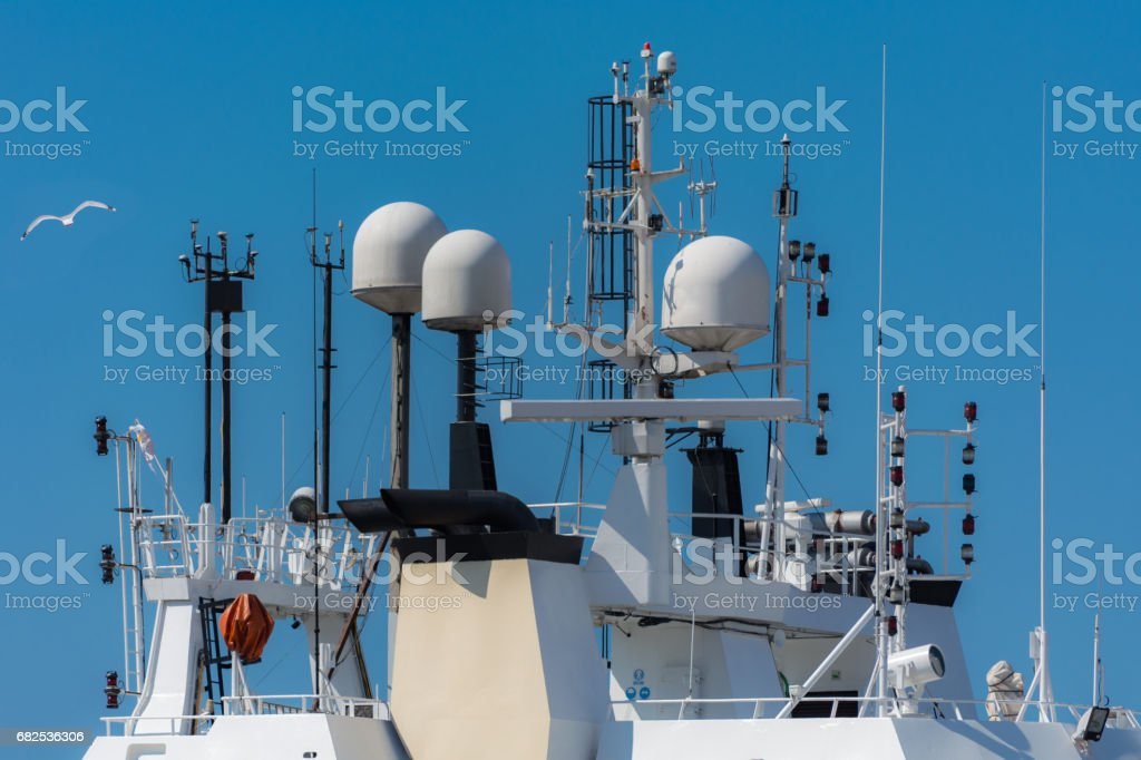 Satellite receivers and radars on  ships stock photo