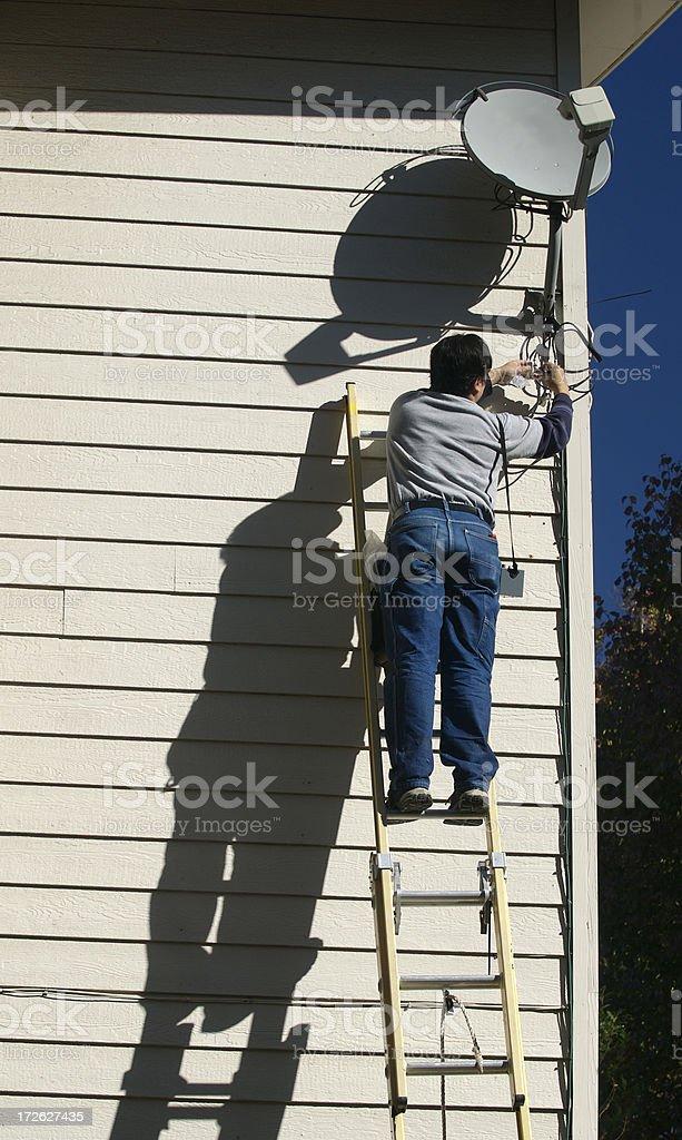 Satellite Television Repair Guy royalty-free stock photo