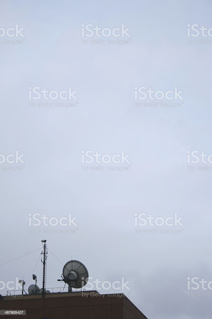 Satellite uplinks on a roof-top royalty-free stock photo