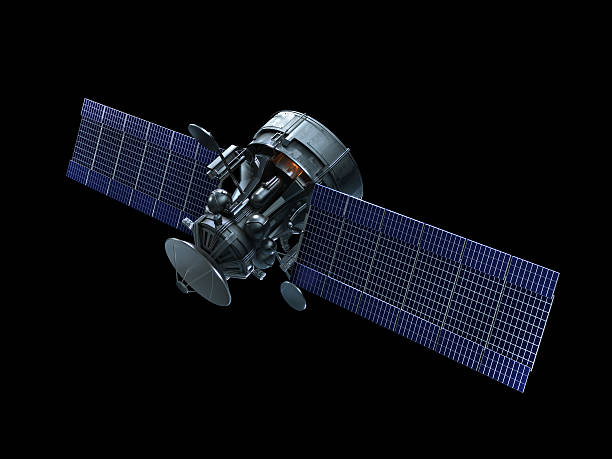 A satellite with blue solar panels on a black background stock photo