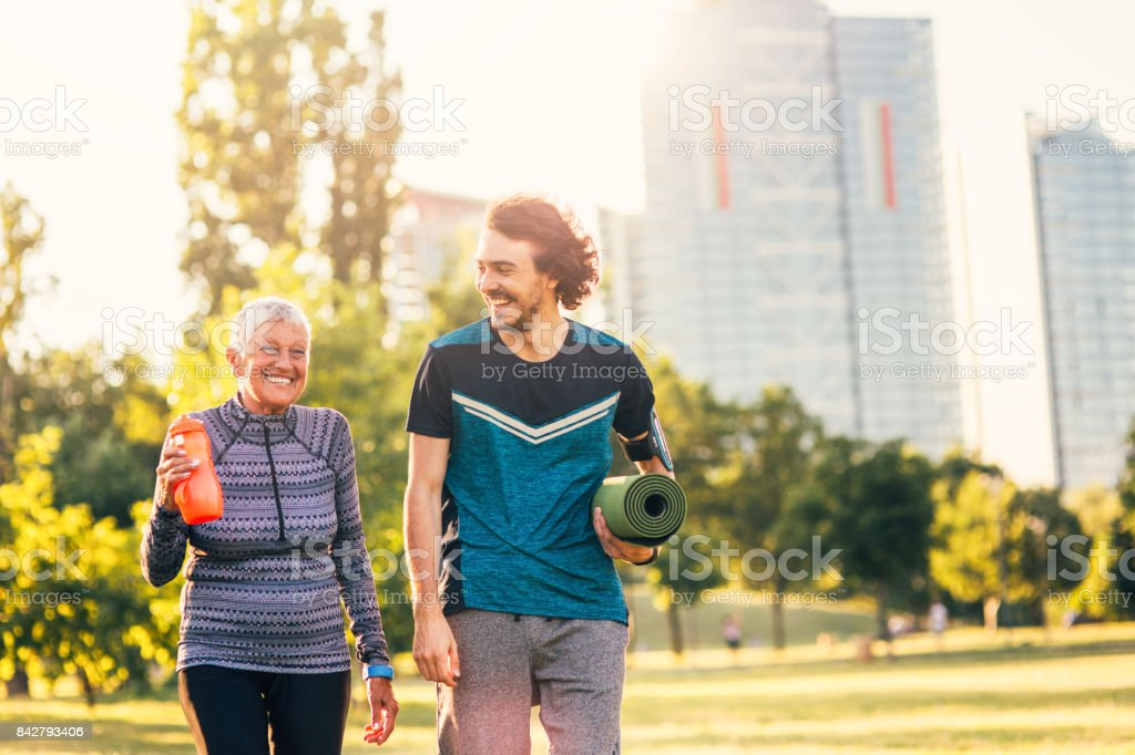 Satified sportspeople returning from practice stock photo