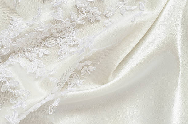 Satin and lace White wedding satiin and embroidered lace lace textile stock pictures, royalty-free photos & images