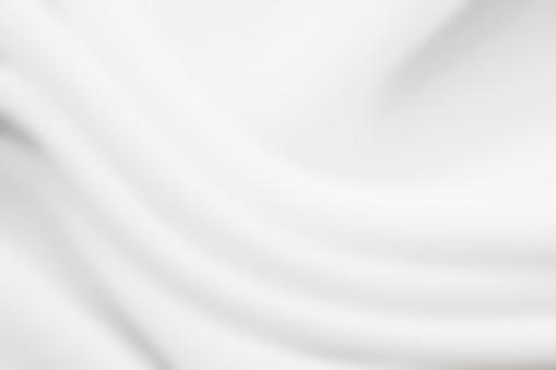 Blured white satin textile.