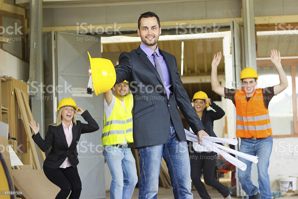Satisfied architect with their workers. royalty-free stock photo