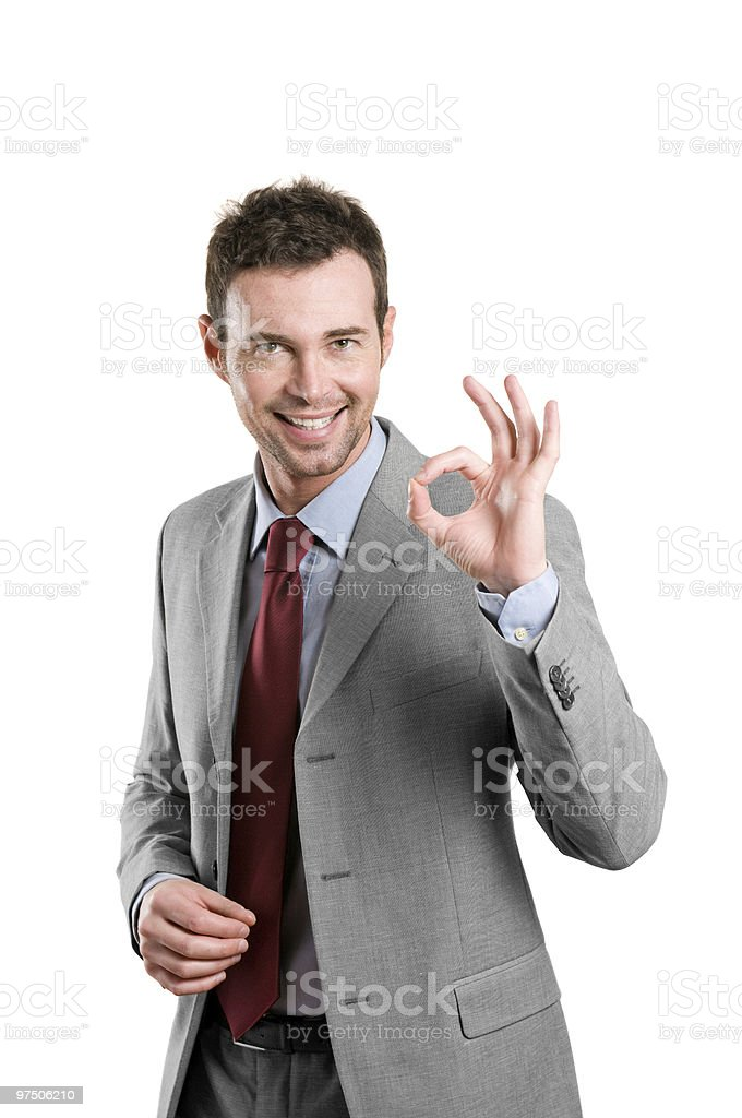 Satisfied business man showing okay sign royalty-free stock photo