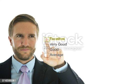 Businessman touching performance list.