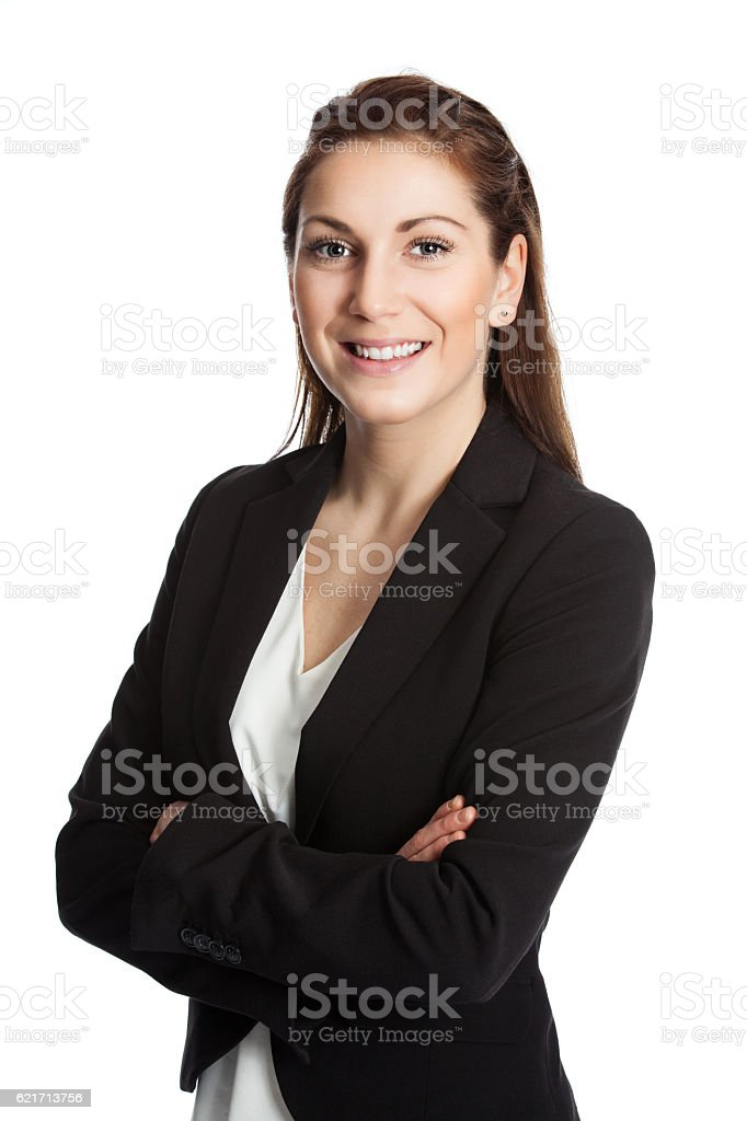 Satisfied businesswoman with arms crossed smiling stock photo