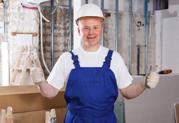 Satisfied construction worker Portrait of satisfied construction worker standing at indoors building site approbation stock pictures, royalty-free photos & images