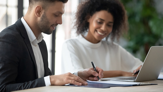843533912 istock photo Satisfied customer signing contract, making deal with African American businesswoman 1247026245