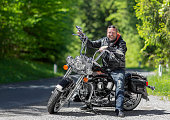 Berchtesgaden, Germany - May 8, 2016: Biker on his Harley Davidson in Alps.