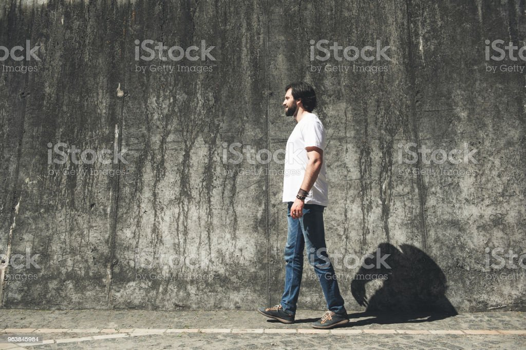 Satisfied man walking down abandoned street - Royalty-free Abandoned Stock Photo