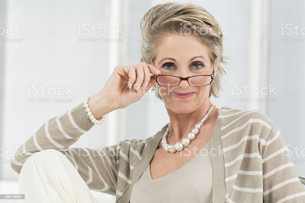 Satisfied Mature Woman Wearing Eyeglass stock photo