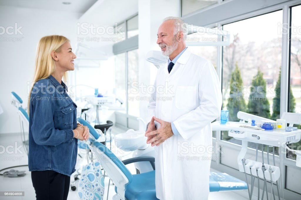 Satisfied patient and dentist in the dentist's office royalty-free stock photo