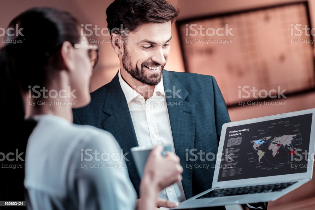 Satisfied qualified worker standing and demonstrating statistic stock photo