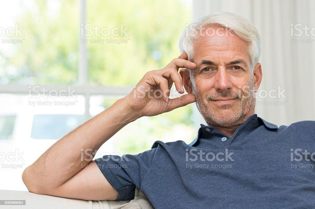 Satisfied senior man stock photo