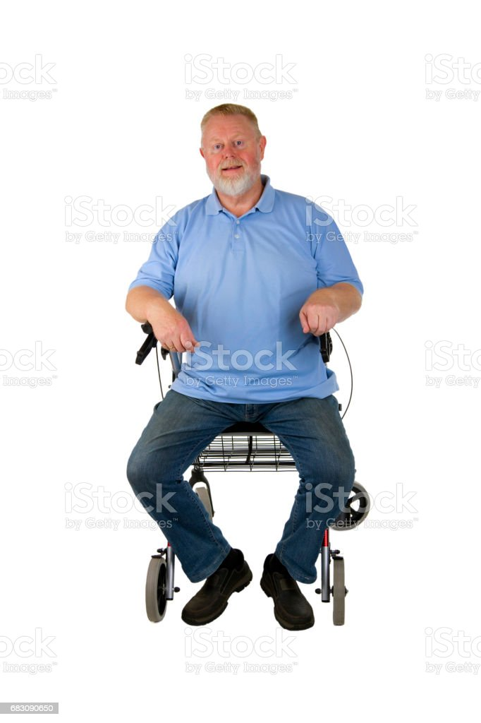 Satisfied senior sitting on walker foto de stock royalty-free