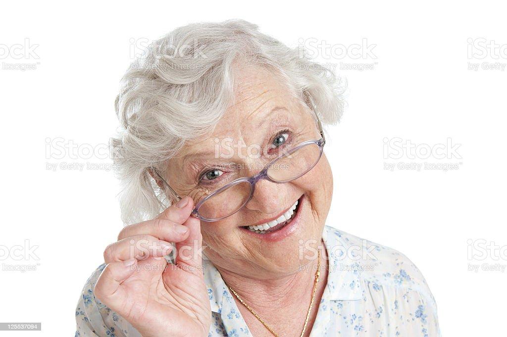 Satisfied senior woman with eyeglasses stock photo