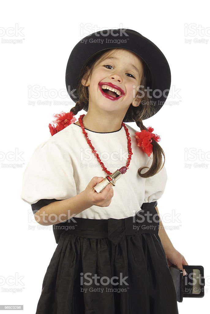 Satisfied smiling little girl with red lipstick royalty-free stock photo